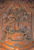 MECHELEN, BELGIUM - JUNE 14, 2014: The carved relief of two slaves with the angel and The Holy Trinity by Ferdinand Wijnants in st. Johns church or Janskerk from 17. cent. — Stock Photo