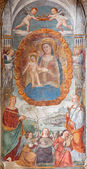 PADUA, ITALY - SEPTEMBER 9, 2014: The Madonna with the child by Bonino da Campione (14. cent.) in the church of The Eremitani (Chiesa degli Eremitani) on the tomb of Umberto da Carrara. — Stock Photo