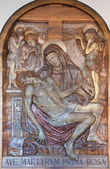 PADUA, ITALY - SEPTEMBER 10, 2014: The relief of Pieta by Amleto Sartori (1940) in church chiesa di Santa Maria del Torresino. — Stockfoto