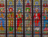 BRUGES, BELGIUM - JUNE 12, 2014: The Saints on the windowpane in St. Salvator's Cathedral (Salvatorskerk) by stained glass artist Samuel Coucke (1833 - 1899). — Stock Photo