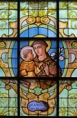 BRUSSELS, BELGIUM - JUNE 15, 2014: St. Anthony of Padua on the windwopane in church Notre Dame aux Riches Claires by Jan van Keer (1904) — Stock Photo
