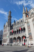 BRUGES, BELGIUM - JUNE 13, 2014: Neo gothic facade of Historium builidnig from years 1910-1914 on the Grote Markt square. — Stock Photo