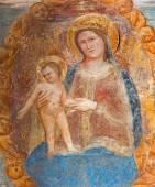 PADUA, ITALY - SEPTEMBER 9, 2014: The Madonna with the child by Bonino da Campione (14. cent.) in church of The Eremitani (Chiesa degli Eremitani) as the detail of tomb of Umberto da Carrara. — Stock Photo