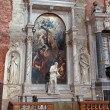 Постер, плакат: VENICE ITALY MARCH 12 2014: Side Zane altar of church Santa Maria Gloriosa dei Frari with the statue of st Jerome by A Vittoria 1564 and The Apotheosis of St Francis of Assisi paint