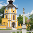 Spisska Kapitula - St. John the Nepomuk column anb clock tower. Unesco monument. — Stock Photo #54213579