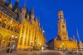 BRUGES, BELGIUM - JUNE 11, 2014: Grote markt with the Belfort van Brugge, Historium and Provinciaal Hof building. — Stock Photo