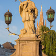 Bruges - The st. John the Nepomuk statue on the bridge and the tower of church of Our Lady. — Stock Photo #54225891