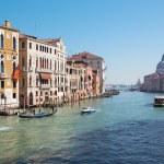 VENICE, ITALY - MARCH 12, 2014: Canal grande under Ponte Accademia and church Santa Maria della Salute — Stock Photo #54229987