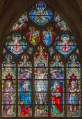 BRUGES, BELGIUM - JUNE 12, 2014: The Crucifixion on the windowpane in St. Salvator's Cathedral (Salvatorskerk) by stained glass artist Samuel Coucke (1833 - 1899). — Stock Photo