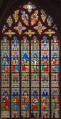 BRUGES, BELGIUM - JUNE 12, 2014: The New Testament scenes on windowpane in St. Salvator's Cathedral (Salvatorskerk) by stained glass artist Samuel Coucke (1833 - 1899) — Stock Photo