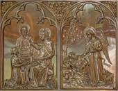 BRUGGE, BELGIUM - JUNE 13, 2014: The Miracle Miracle of Multiplying Food and the Angel give the bread to prophet Elijah scene. Neogothic metal relief in st. Giles (Sint Gilliskerk). — Stock Photo
