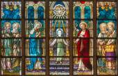 BRUGES, BELGIUM - JUNE 12, 2014: The Holy family on the windowpane in St. Salvator's Cathedral (Salvatorskerk) by stained glass artist Samuel Coucke (1833 - 1899). — Stock Photo