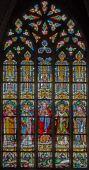 MECHELEN, BELGIUM - JUNE 14, 2014: The heart of Jesus and the saints on windowpane in st. Katharine church or Katharinakerk. — Stock fotografie
