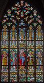 MECHELEN, BELGIUM - JUNE 14, 2014: The heart of Jesus and the saints on windowpane in st. Katharine church or Katharinakerk. — Stock Photo