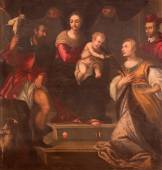 PADUA, ITALY - SEPTEMBER 9, 2014: The paint  on the main altar of Oratorio di San Rocco. Madonna with the saints by Alesssandro Maganza (1697). — Stock fotografie