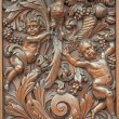 BRUGES, BELGIUM - JUNE 13, 2014: The carved symbolic relief of angels with the bird in Karmelietenkerk (Carmelites church) by carmelite Victor van de Heilige Jacob from 17. cent. — Stock Photo #54241175