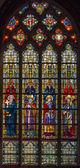 BRUGGE, BELGIUM - JUNE 13, 2014: The Windowpane with the saints in the in st. Giles (Sint Gilliskerk). — Stock Photo