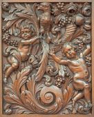 BRUGES, BELGIUM - JUNE 13, 2014: The carved symbolic relief of angels with the bird in Karmelietenkerk (Carmelites church) by carmelite Victor van de Heilige Jacob from 17. cent. — Stock Photo