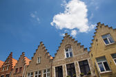 Bruges - The cloud heart over the typically bick houses of the town. — Stock Photo