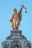 BRUGES, BELGIUM - JUNE 12, 2014: The statue of Justice on the facade of house on Burg square in morning light. — Stock Photo
