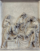 BRUSSELS, BELGIUM - JUNE 15, 2014: Stone relief the Burial of Jesus scene in church Notre Dame du Bon Secource. — Stock Photo