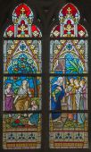 BRUGES, BELGIUM - JUNE 12, 2014: Scenes Sarah and the vistitation of God to Abraham and the Little st. John the Baptist and Jesus on the windwopane in st. Jacobs church by J. Dobbelare (1901). — Stock Photo