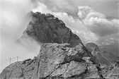 Alps - Watzmann peak (2713) in the cloud from summit of Hocheck (2651). — Stock Photo