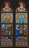 BRUGES, BELGIUM - JUNE 12, 2014: Scenes The Presentation of Jesus in the Temple and The Moses rescued from the Nile st. Joseph on windwopane in st. Jacobs church (Jakobskerk) by J. Dobbelare (1901). — Stok fotoğraf