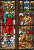 TRNAVA, SLOVAKIA - OCTOBER 14, 2014: The Virgin Mary of Loures and st. Bernadette Soubirous windowpane in St. Nicholas church and Virgin Mary chapel. — Stock Photo