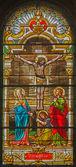 TRNAVA, SLOVAKIA - OCTOBER 14, 2014: The crucifixion in baroque windowpane in St. Nicholas church and Virgin Mary chapel. — Stock Photo