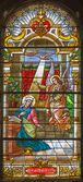 TRNAVA, SLOVAKIA - OCTOBER 14, 2014: The annunciation in baroque windowpane in St. Nicholas church and Virgin Mary chapel. — Stock Photo