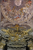 TRNAVA, SLOVAKIA - OCTOBER 14, 2014: The fresco in cupola with the Coronation of Virgin Mary by A. Hess in St. Nicholas church and baroque altar of  Virgin Mary chapel designed by A. Huetter. — Stock Photo