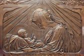 TRNAVA, SLOVAKIA - OCTOBER 14, 2014: The metal secession relief of Madonna with the child in Virgin Mary chapel in St. Nicholas church by unknown artist. — Stock Photo