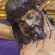 SEVILLE, SPAIN - OCTOBER 28, 2014: The detail of carved Jesus Christ statue on the cross in church Iglesia de San Roque. — Stock Photo #58898749