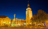 TRNAVA, SLOVAKIA - OCTOBER 14, 2014: The Main square with the bell-tower and the holy Trinity baroque column. — Stock Photo