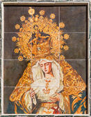 SEVILLE, SPAIN - OCTOBER 27, 2014: The ceramic tiled cried Madonna (Lady of Sorrow) with the cross by artist Enrique Orce Marmol on the church Iglesia San Roque. — Stock Photo