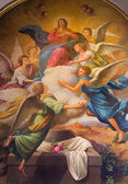 SEVILLE, SPAIN - OCTOBER 28, 2014: The neo - baroque fresco of Assumption of Virgn Mary in the presbytery of church Capilla Santa Maria de los Angeles by Rafael Rodriguez Hernandez from 20 cent. — Stockfoto