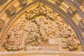 SEVILLE, SPAIN - OCTOBER 28, 2014: The relief of Assumption of Virgin Mary (1877 - 1898) by Ricardo Belver on the main west portal of Cathedral de Santa Maria de la Sede. — Stock Photo