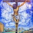 SEVILLE, SPAIN - OCTOBER 28, 2014: The ceramic tiled Crucifixion on the facade of church Iglesia de la Anunciacion at dusk by Antonio Kierman (1949) — Stock Photo #58950061