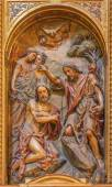 SEVILLE, SPAIN - OCTOBER 29, 2014: The carved polychrome relief of the Baptism of Christ in church Iglesia de la Anunciacion by Martinez Montanes from 18. cent. — Stock Photo
