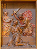 SEVILLE, SPAIN - OCTOBER 29, 2014: The carved polychrome relief of decapitation of  St. John the Baptist in church Iglesia de la Anunciacion by Martinez Montanes from 18. cent. — Stock Photo