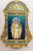 SEVILLE, SPAIN - OCTOBER 29, 2014: The ceramic tiled Madonna by A. Morilla from 20. cent. in manufacture Ceramica Santa Ana de Triana on the fadade of church Iglesia de Santa Maria de las Nieves. — Stock Photo