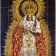 SEVILLE, SPAIN - OCTOBER 29, 2014:  The ceramic tiled Madonna in the church Basilica del Maria Auxiliadora by A. Morilla from 20. cent. — Stock Photo #59098017
