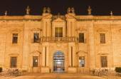Seville - The facade of University fromer Tobacco Factory at night. — Zdjęcie stockowe