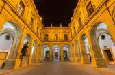 Seville - The atrium of University fromer Tobacco Factory at night. — Stock Photo