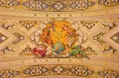 SEVILLE, SPAIN - OCTOBER 29, 2014: The fresco angels and the monogram of Virgin Mary on the ceiling in church Basilica de la Macarena by Rafael Rodrguez (1949) in neobaroque style. — Stock Photo