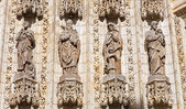 SEVILLE, SPAIN - OCTOBER 28, 2014: The statues of holys on the main west portal (Puerta de la Asuncion) of Cathedral de Santa Maria de la Sede from neo gothic restoration in years 1883 - 1898. — Stock Photo