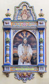 SEVILLE, SPAIN - OCTOBER 29, 2014: The ceramic tiled Christ in the bond by from 20. cent. by artist Enrique Orce Marmol on the facade of church Iglesia San Juan de la Palma. — Stock Photo