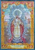 SEVILLE, SPAIN - OCTOBER 29, 2014: The ceramic tiled Madonna (Nuestra Senora de Montemayor) from 20. cent. by artist Enrique Orce Marmol on the facade of church Iglesia San Juan de la Palma. — Stock Photo