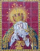 SEVILLE, SPAIN - OCTOBER 29, 2014: The ceramic tiled cried Madonna (Lady of Sorrow) on the facade of church Iglesia los Terceros by A. Morilla from 20. cent. — Stock Photo
